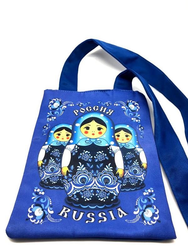 Bolso azul con muñecas