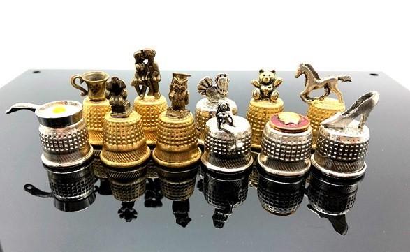 "Dedal ""Figuritas de metall"""