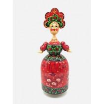 La muñeca es musical, roja.