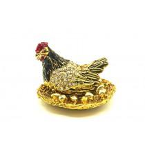 Pollo en el nido con huevos dorados - Caja de Fabergé.
